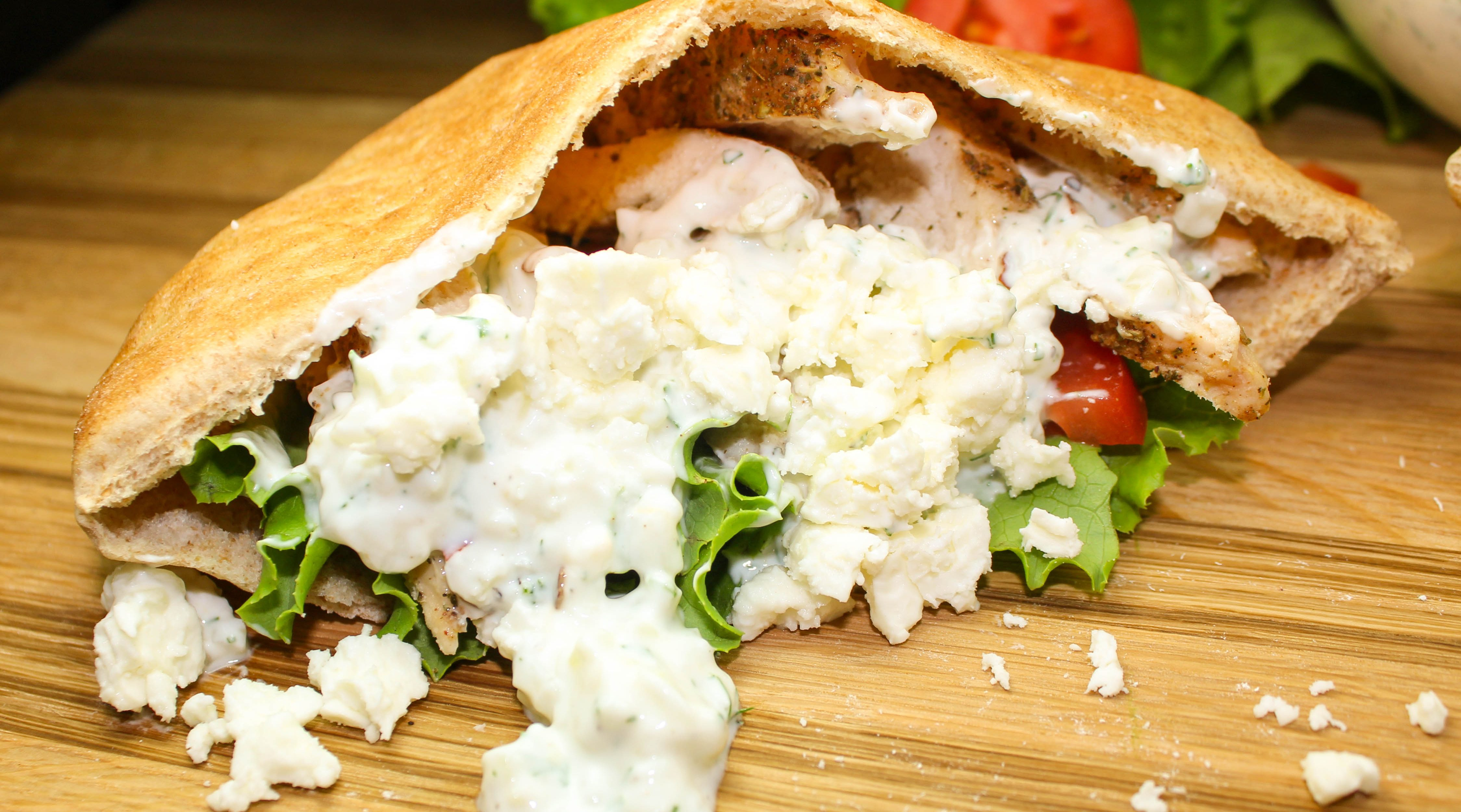 Healthy Chicken Gyros- Healthy version of traditional Gyro that's low fat but full of flavor. Greek seasoned chicken, wrapped in a whole wheat pita pocket & topped with Homemade Tzatziki Sauce. Great for a quick weeknight meal or for week day lunches! Weight Watcher friendly (6 SmartPoints)!