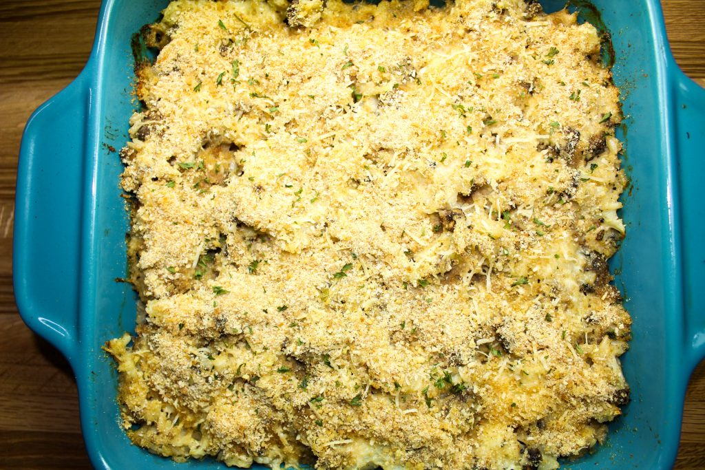 Diced cauliflower, mushrooms, & brown rice mixed with a cheese gravy baked into a casserole dish.