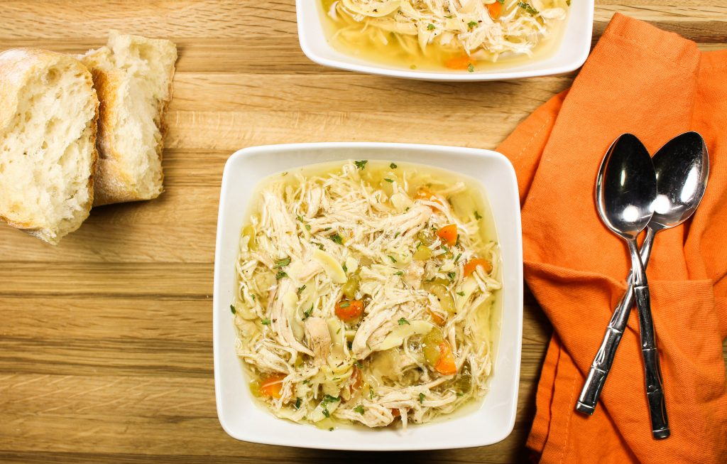Slow Cooker Chicken Noodle Soup is comfort in a bowl! Perfect for cold days & when you're under the weather. Hearty vegetables, shredded chicken, and delicious broth are the perfect combination. Easy to make & healthy! Weight Watcher friendly recipe. www.bitesofflavor.com