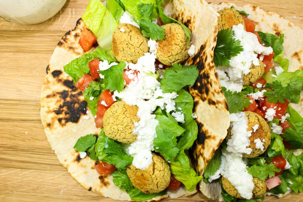Baked Falafel Tacos are a unique twist to healthy tacos at home. Crispy baked falafel topped with creamy tzatziki sauce and wrapped in a corn tortilla make for the perfect dinner. Weight Watchers friendly recipe! www.bitesofflavor.com