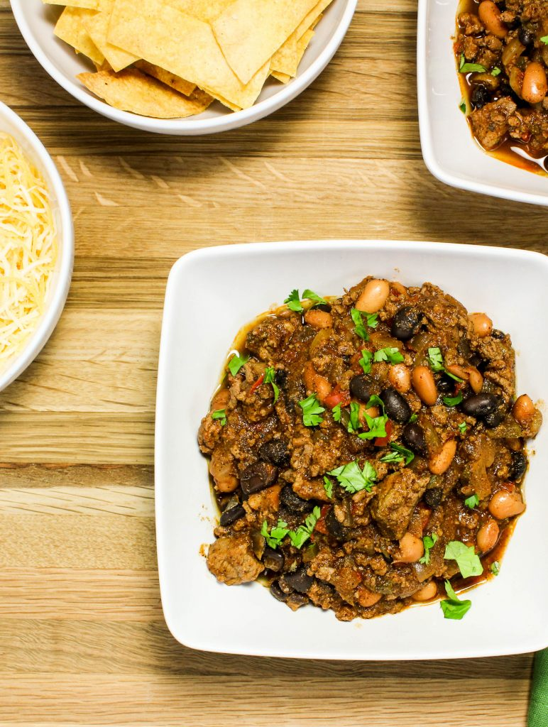 Slow Cooker Beef & Bean Texas Chili-Two beef & bean chili with the perfect bite of spice to make you warm up on a chilly day. Weight Watcher friendly (7 SmartPoints). www.bitesofflavor.com