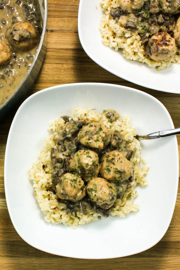 Turkey Meatballs in Creamy Mushroom Gravy is comfort food in a bowl. Flavorful turkey meatballs cooked in a decadent, yet healthy, creamy mushroom gravy & served on a bed of rice. Weight Watchers friendly recipe. www.bitesofflavor.com
