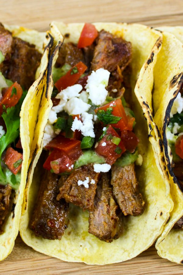 Asada flavored grilled steak sliced and served in a tortilla & topped with fresh Pico de Gallo & Avocado Crema.