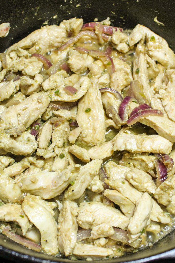 Sliced Chicken cooking with onions