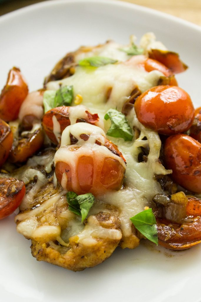 Skillet Caprese Chicken- Lean chicken breast topped with delicious tomatoes, balsamic vinegar, & cheese all made in under 30 minutes! Weight Watchers friendly. www.bitesofflavor.com