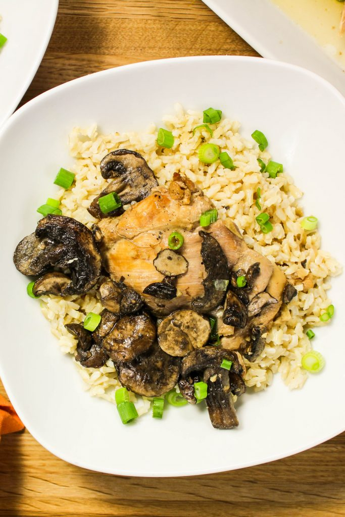 Slow Cooker Adobo Chicken and Mushrooms- Chicken thighs & mushrooms cooked low & slow in a delicious blend of Asian flavors. Weight Watchers friendly. www.bitesofflavor.com