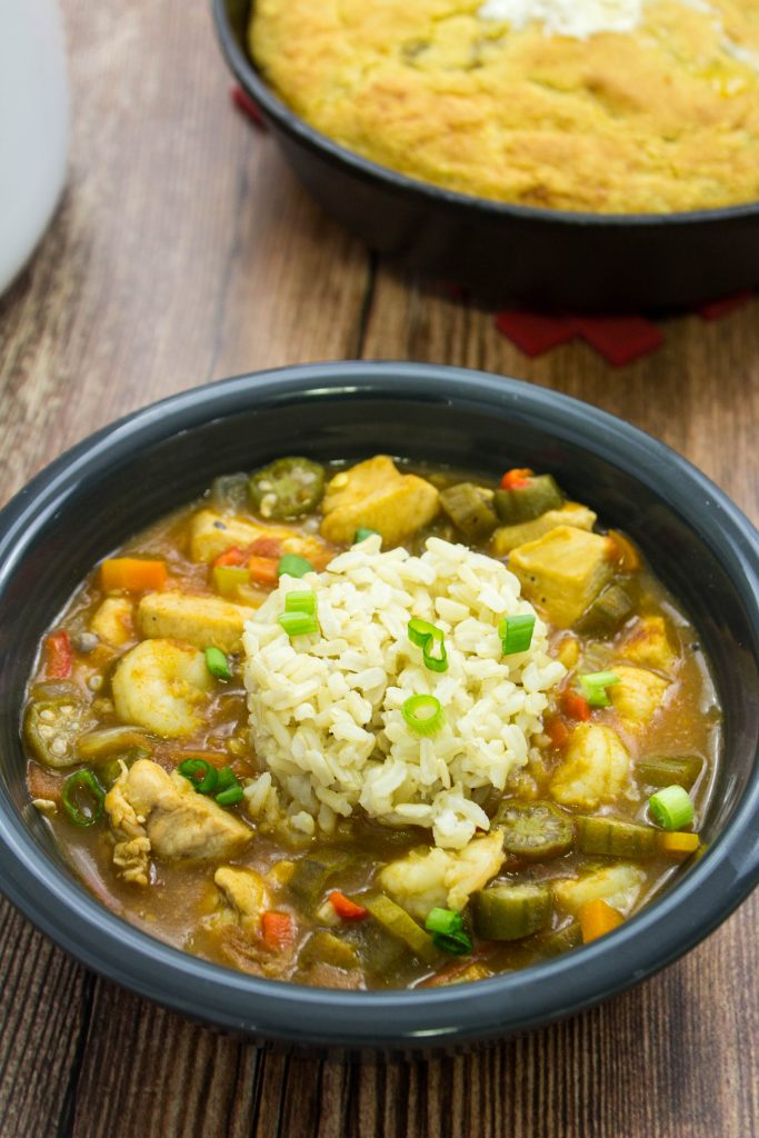 Chicken & Shrimp Gumbo is a healthy twist on the classic Cajun dish. Diced chicken, vegetables, okra, & shrimp cooked in a decadent, perfectly spiced broth is delicious with every bite. Weight Watchers friendly recipe! www.bitesofflavor.com