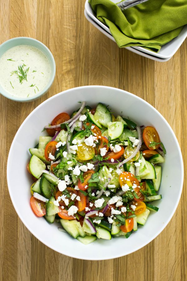 Sliced cucumbers and grape tomatoes tossed in a creamy herb vinaigrette topped with feta cheese.