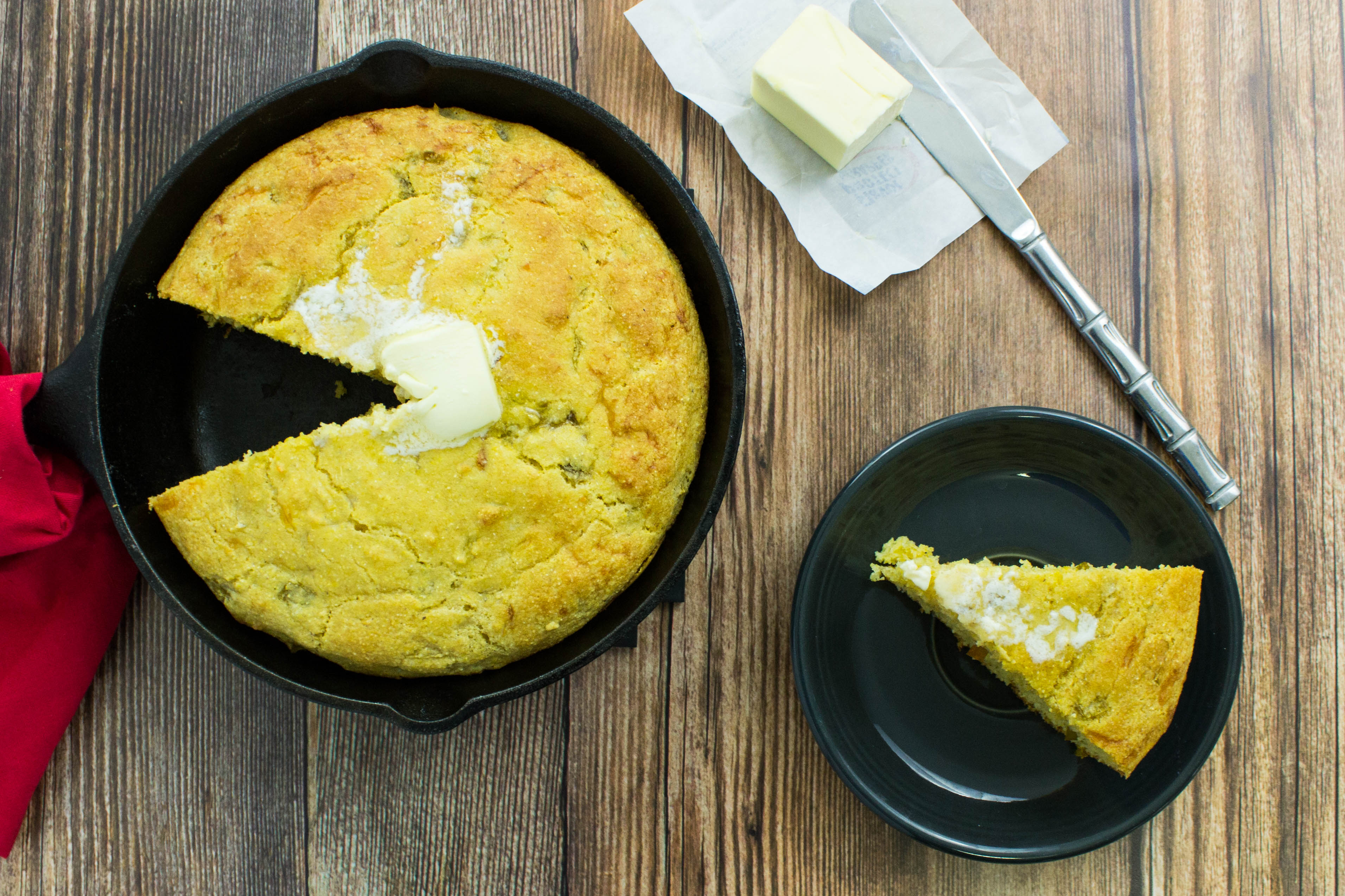 Skillet Green Chili Cornbread- Fluffy cornbread with layers of cheese & green chilies! Unique & healthy twist on traditional cornbread. Weight Watcher friendly. www.bitesofflavor.com