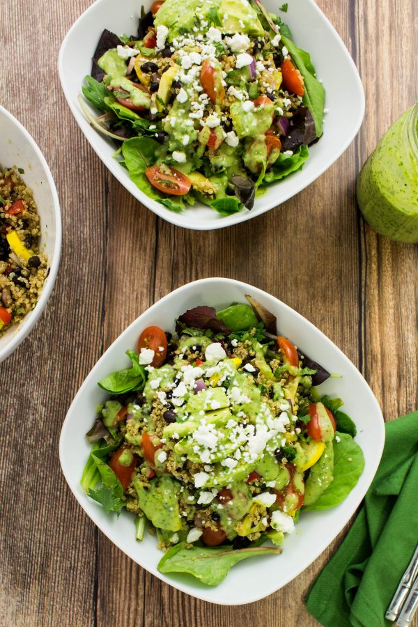 Grilled Vegetable Quinoa Salad is a delicious blend of grilled squash, bell pepper, and onion with quinoa, black beans, & lettuce topped with creamy avocado dressing is a delicious bite! Weight Watchers friendly recipe. www.bitesofflavor.com