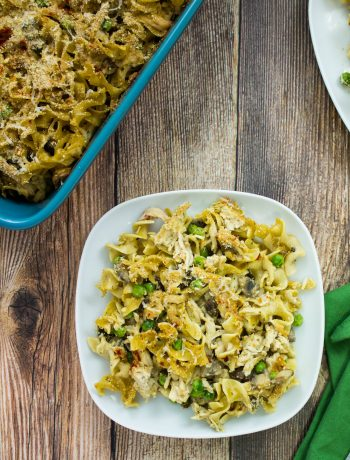 Turkey Noodle Casserole is a healthy take on the classic casserole dish. Delicious shredded turkey mixed with homemade cream of mushroom, peas, cheese, and egg noodles. Weight Watchers friendly recipe. www.bitesofflavor.com