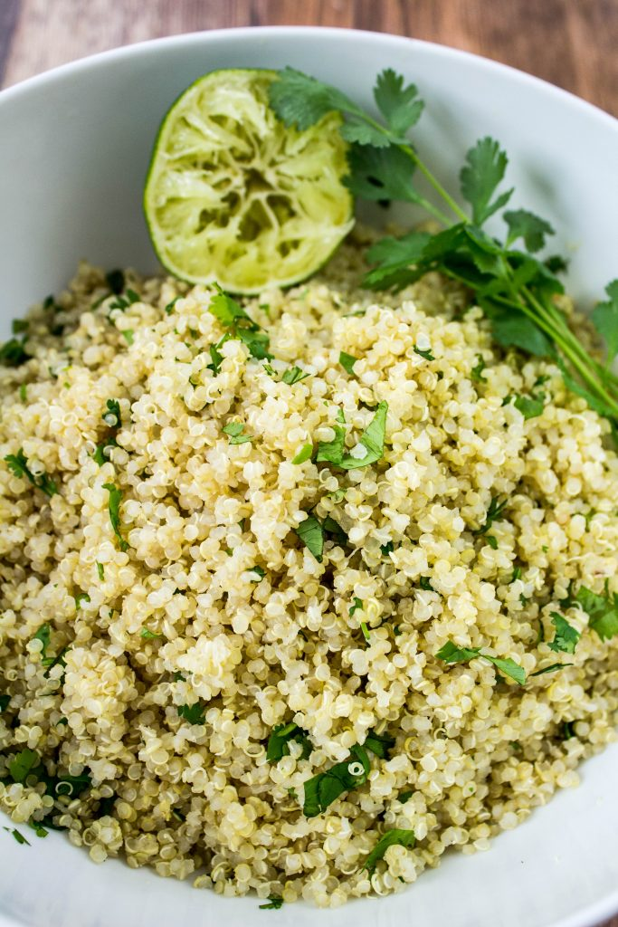 Cilantro Lime Quinoa is fluffy quinoa mixed with fresh cilantro & lime juice is light, zesty, & full of flavor. Weight Watchers friendly recipe. www.bitesofflavor.com