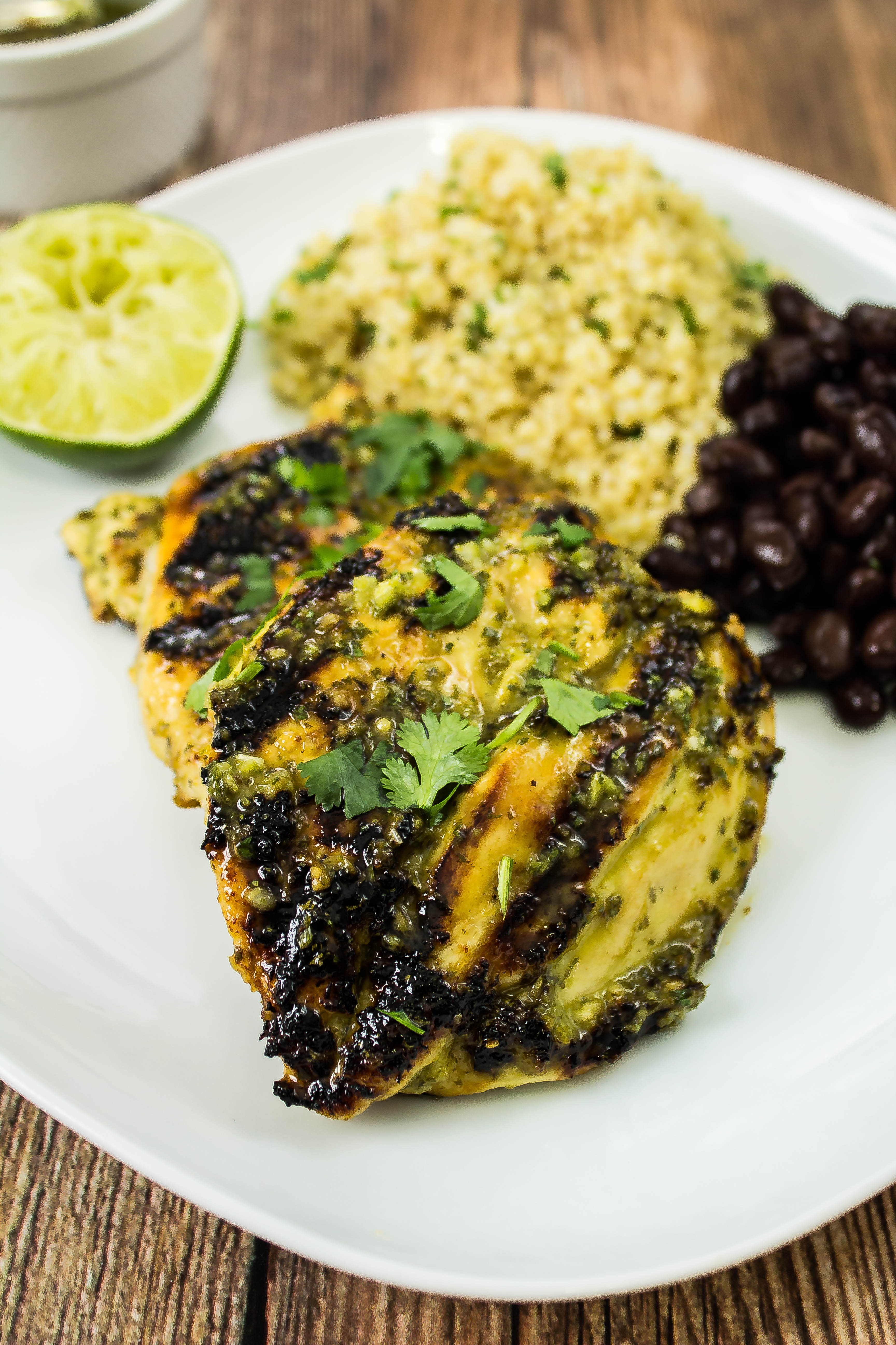 Grilled Cilantro Lime Chicken is grilled chicken coated in cilantro lime marinade is delicious served by itself, in a taco, or served in a burrito bowl. Weight Watchers friendly recipe. www.bitesofflavor.com