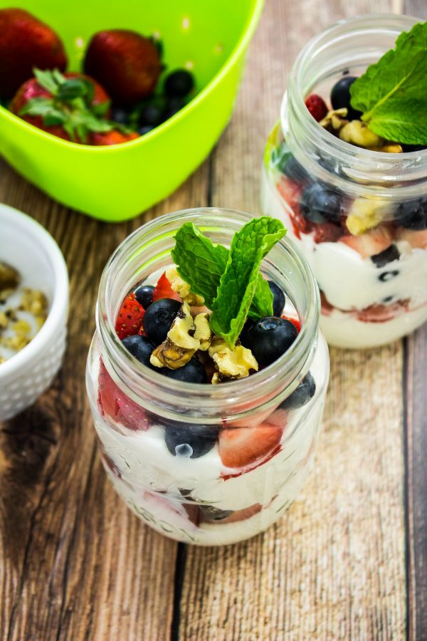 Red White & Blueberry Yogurt Trifle is vanilla Greek Yogurt layered with blueberries, strawberries, & walnuts is sure to satisfy your sweet tooth. Weight Watchers friendly. www.bitesofflavor.com