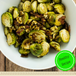 Roasted brussel sprouts covered in a honey dijon sauce mixed with bacon and roasted walnuts