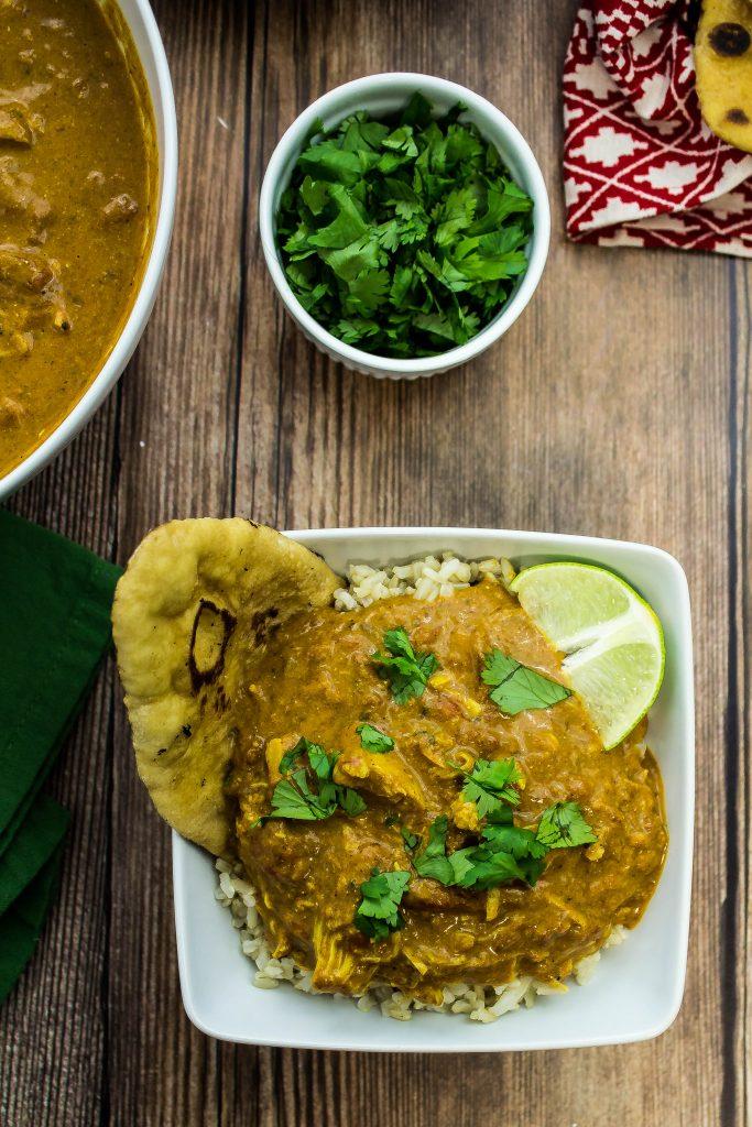 This Slow Cooker Chicken Tikka Masala is comfort in a bowl. Weight Watchers friendly recipe. www.bitesofflavor.com