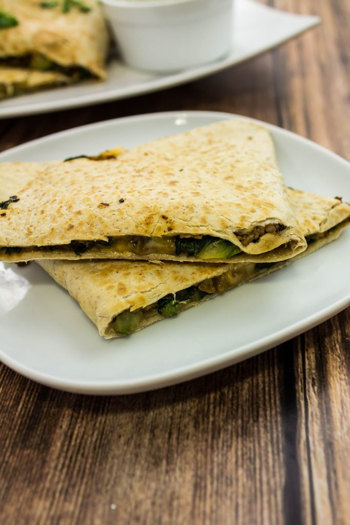 Soyrizo Veggie Quesadillas is made of soy meat mixed with zucchini, spinach, with two types of cheese & stuffed inside a crispy tortilla. Weight Watchers friendly. www.bitesofflavor.com