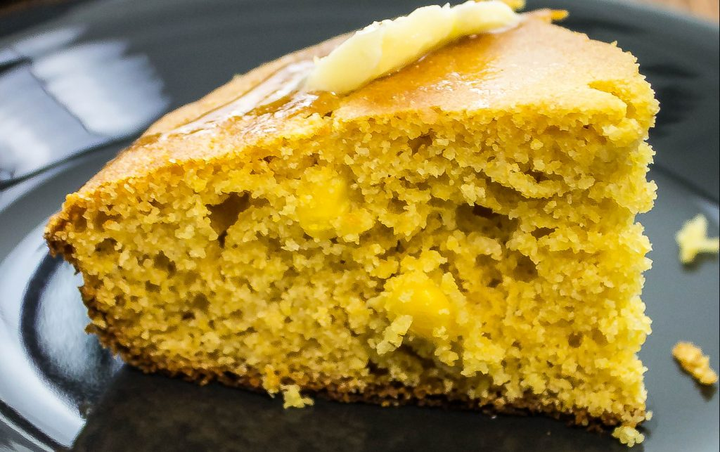 This Sweet Skillet Cornbread is fluffy cornbread with a layer of corn kernels & a touch of sweetness is the perfect side for any gumbo, stew, or chili. Weight Watchers friendly recipe. www.bitesofflavor.com