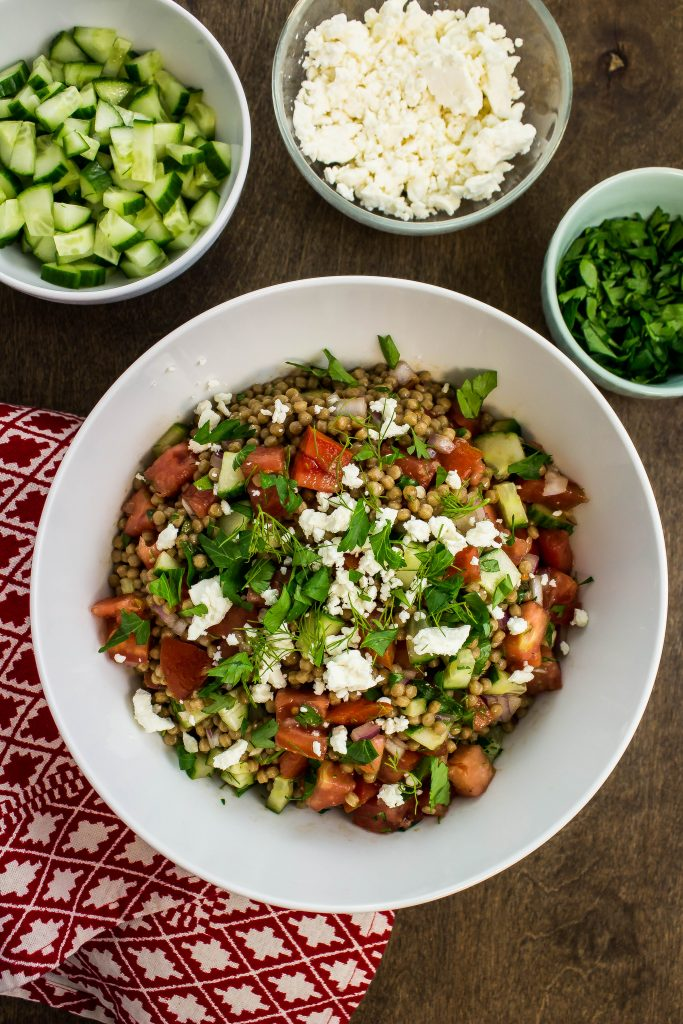 Greek Couscous Salad is a delicious blend of fresh ingredients perfect for a side dish or lunch.  Weight Watchers friendly recipe!  www.bitesofflavor.com