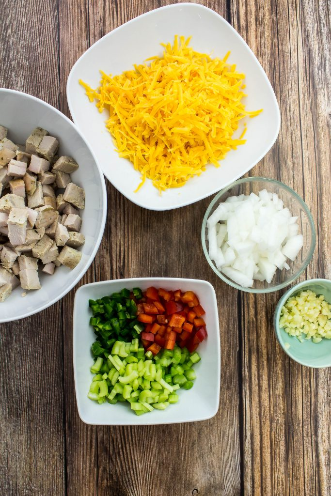 bowl of diced turkey, bowl of cheese, bowl of diced vegetables