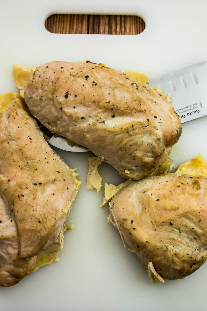 cooked turkey breast on a cutting board