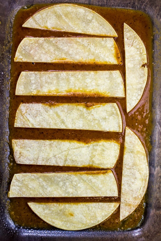tortilla strips in a casserole dish