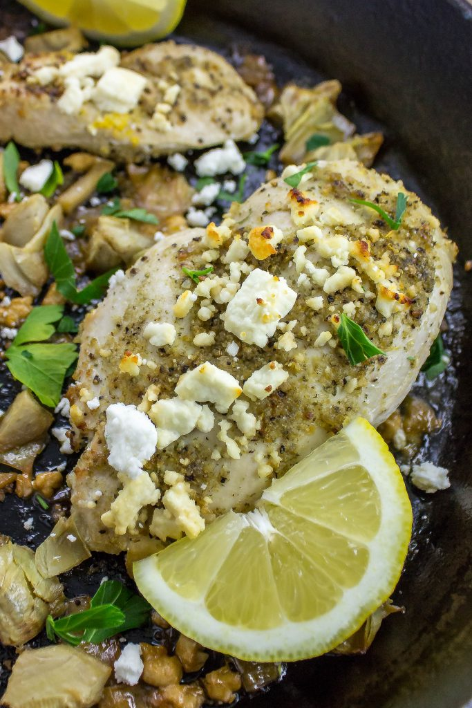Baked chicken with lemon sauce, artichokes, and feta cheese