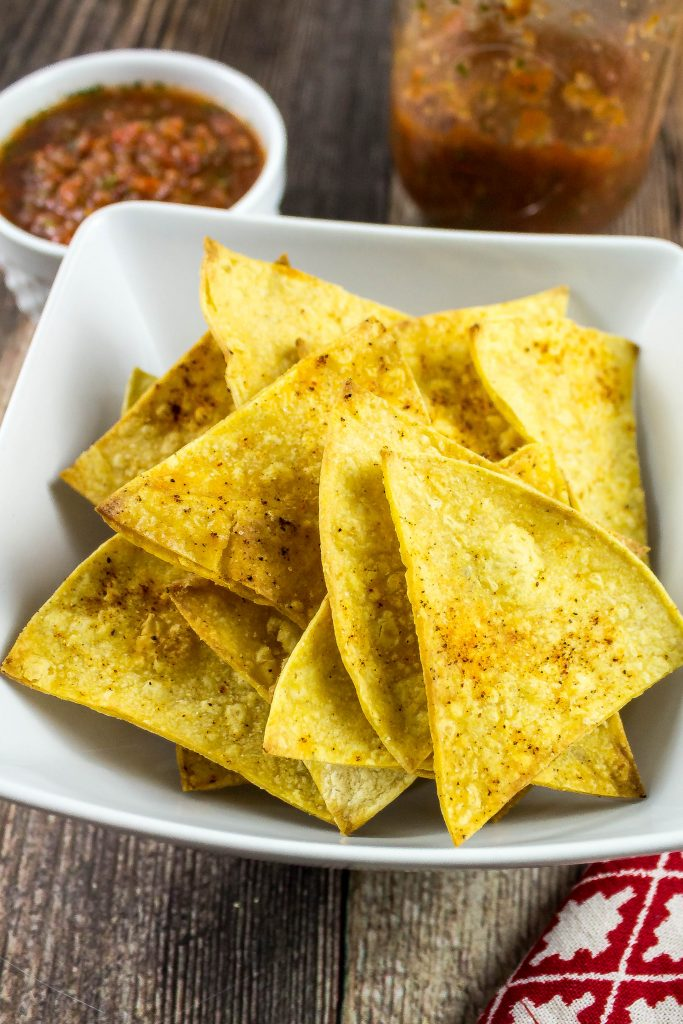 Baked Tortilla Chips are a healthy alternative to store bought chips. Easy to make and only a few ingredients! Weight Watchers friendly recipe. www.bitesofflavor.com