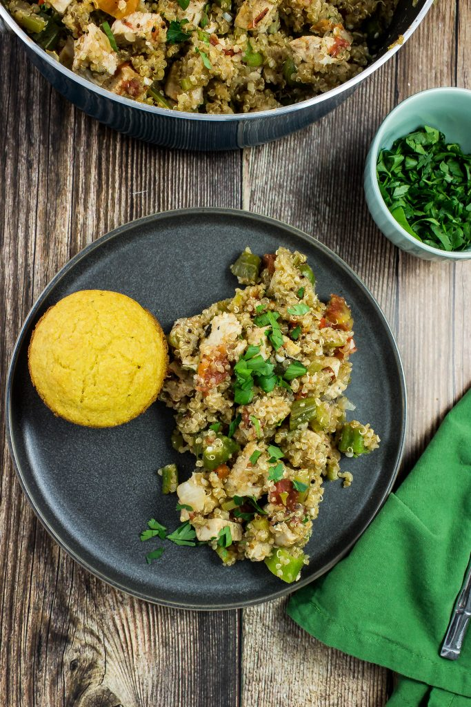 Oven roasted turkey breast, cajun spices, quinoa, and vegetables cooked together in a skillet