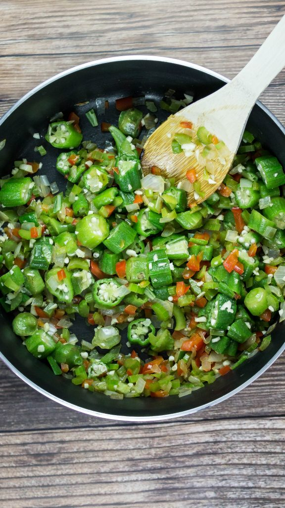 Diced okra and veggies in a skillet
