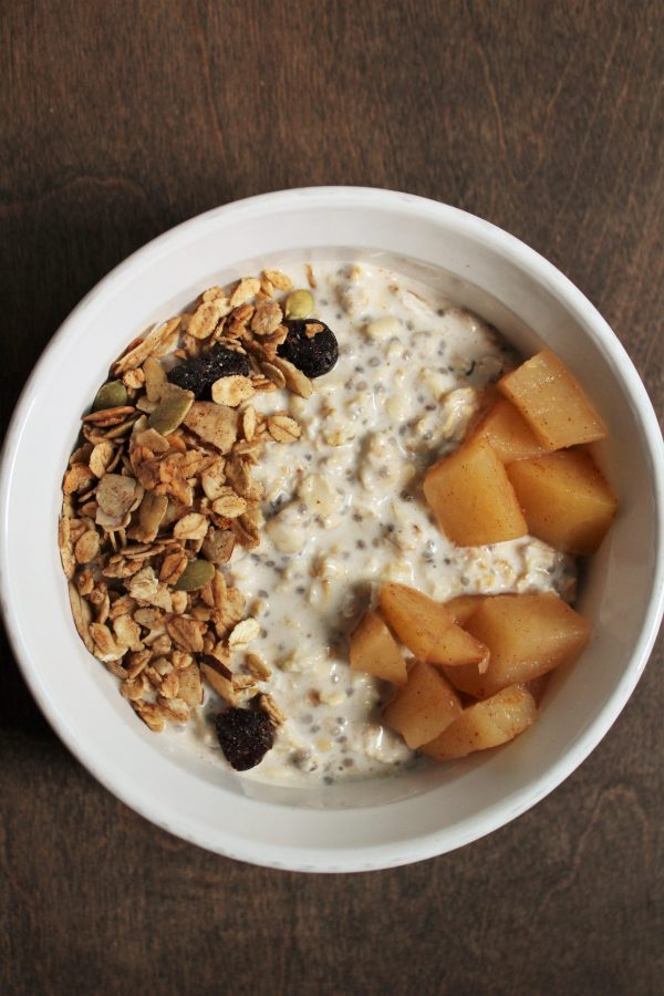 Oats mixed with almond milk, yogurt, syrup, chia seeds, and almond butter