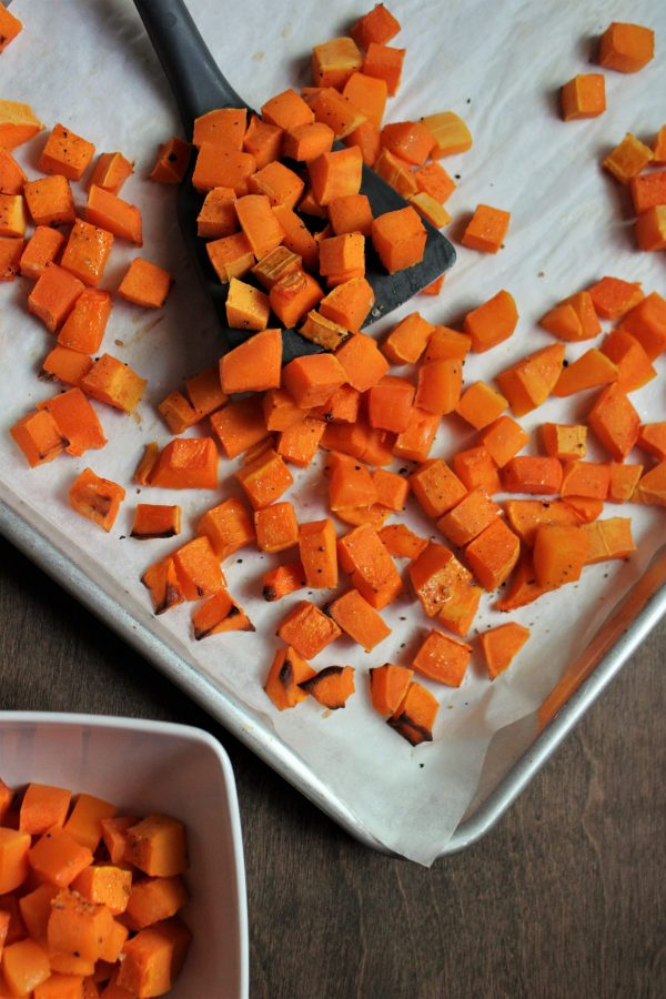 diced roasted butternut squash on a baking sheet