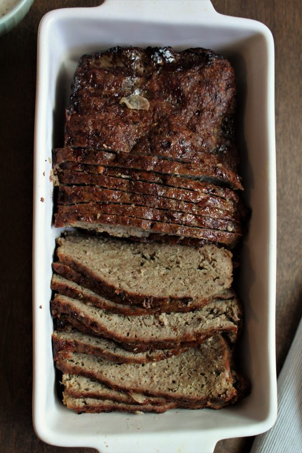 Ground beef and lamb mixed with onion, garlic, and Greek spices formed into a meatloaf and baked.
